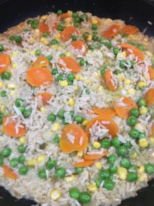 Buzymum - Coconut milk and veg added to chicken curry