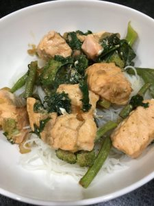 Buzymum - Salmon stir-fry on a bed of rice noodles