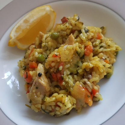 Buzymum - Chicken and chorizo paella served with a wedge of lemon