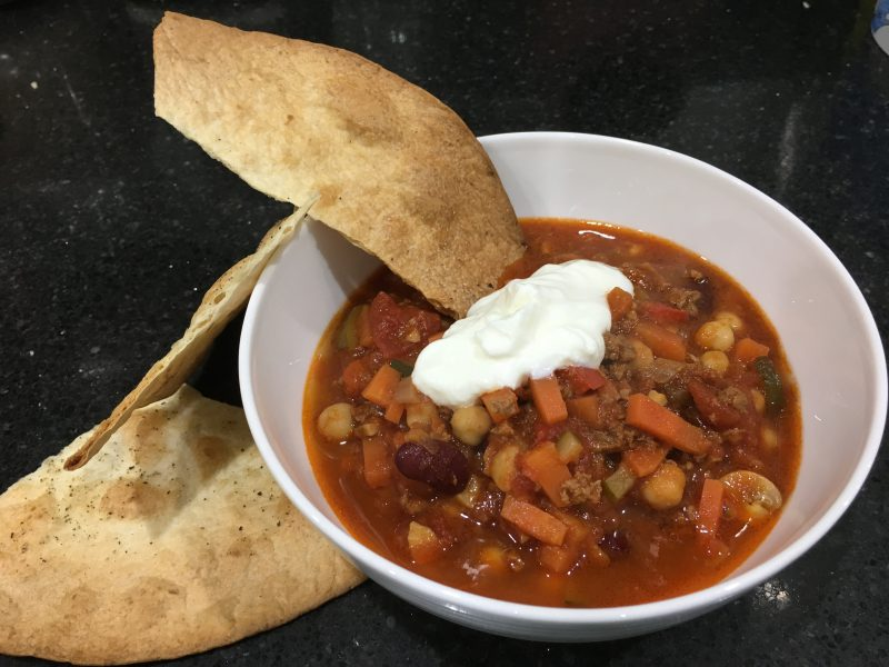 Buzymum - Chilli served with sour cream and crispy tortillas