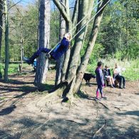 Buzymum - Kids playing on a rope swing in the woodland