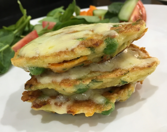 Buzymum - Cheesy carrot, courgette and pea fritters served with salad